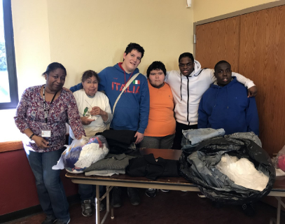 students and staff together at Soup Kitchen