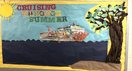 """Cruising Through Summer"" on a classroom bulletin board"