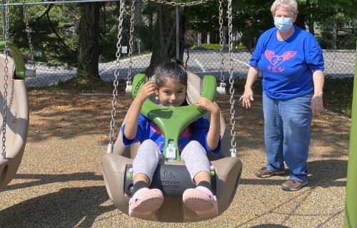 Student swinging.