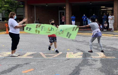 Student going through banner.
