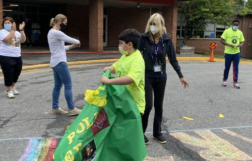 Students going through green finish line.