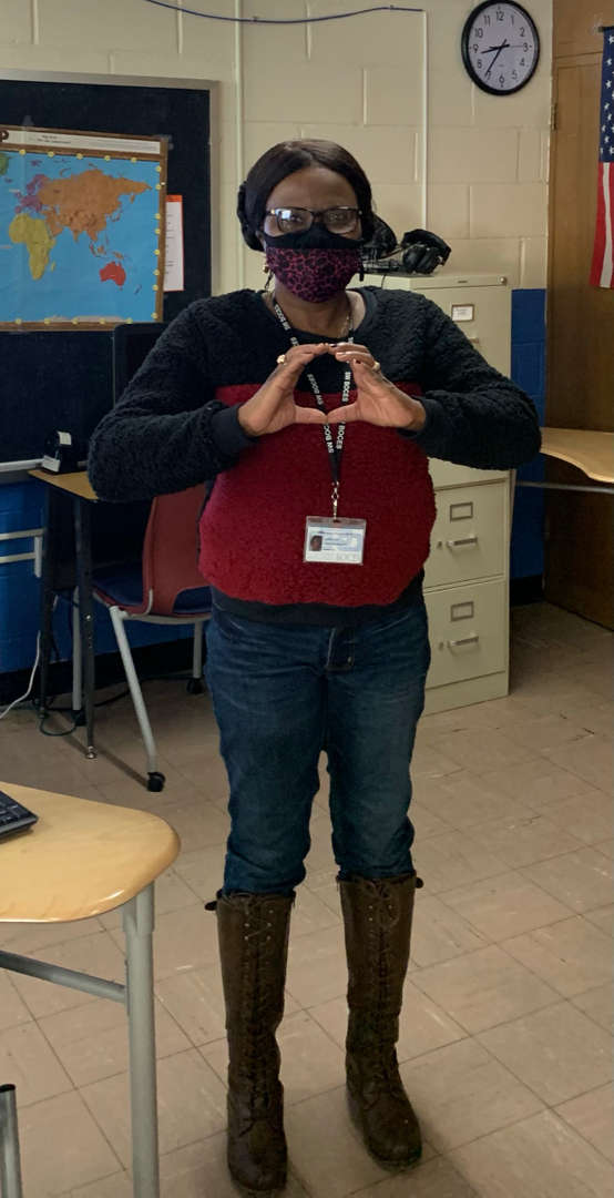 Staff member making a heart with two hands