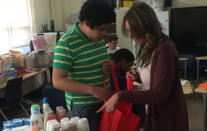 Student and staff filling the bags