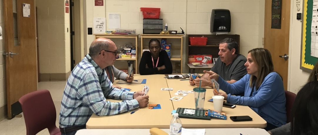 Staff playing cards to learn differential planning