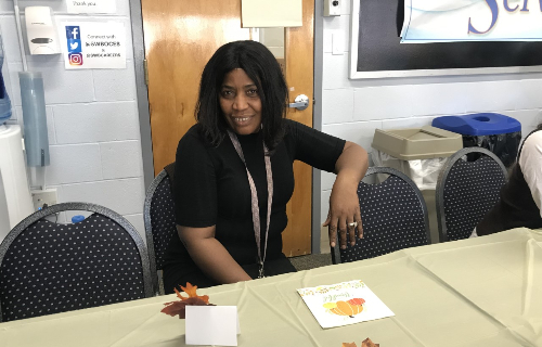 Teacher Assistant at the table smiling