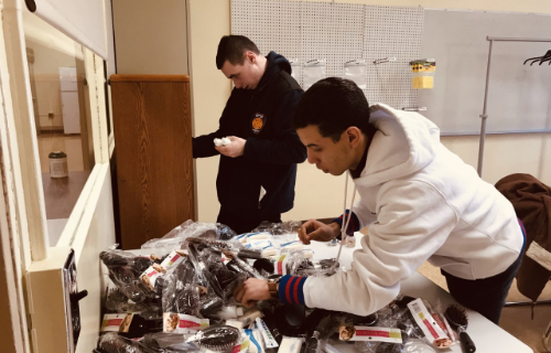Two students organizing the supplies in the work based learning center