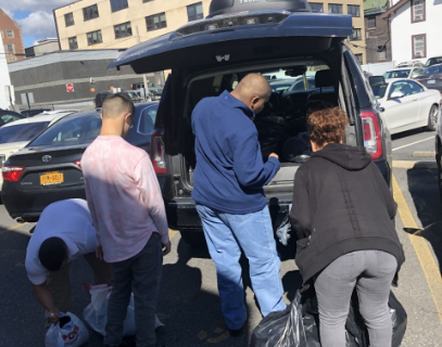 Students putting donations in car