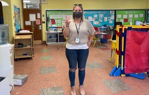Teacher holding 3