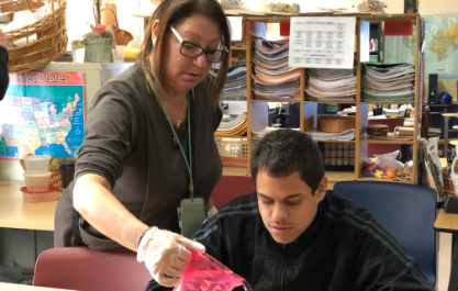 Student and Staff working with clay