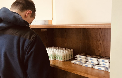 Student organizing soap and lotion