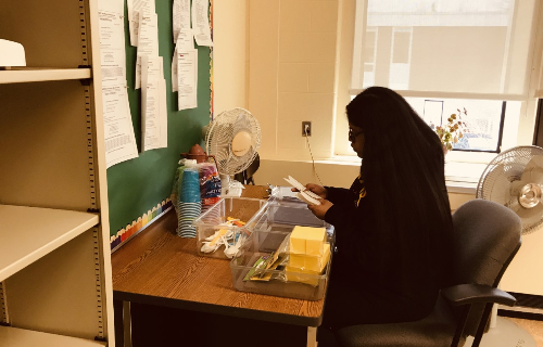 Student working at desk in work center