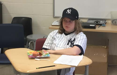 Student dressed as a Yankee player sitting