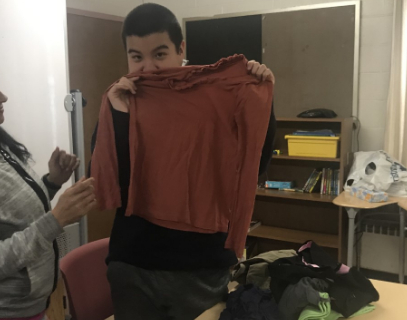 Student holding up a shirt
