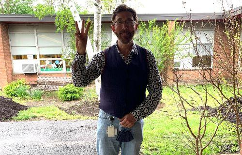 Psychologist poses outside.