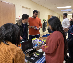Students working a snack stand