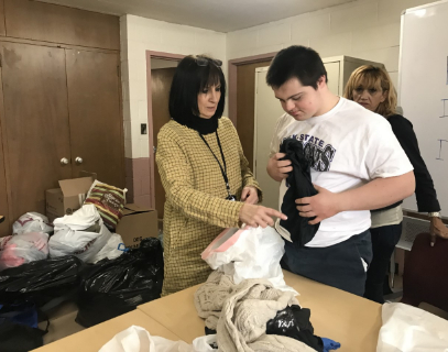 Teacher teaching student how to fold