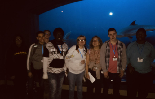 Students in front of whale at the museum