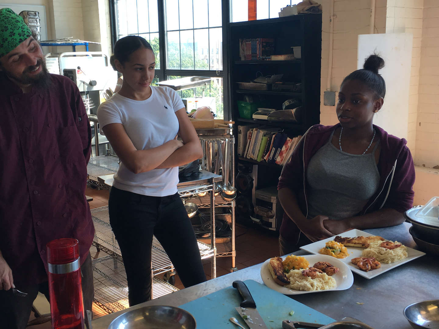 Culinary students Crystal Lee Aulet and Queency Kelly describe their dish to Chef.