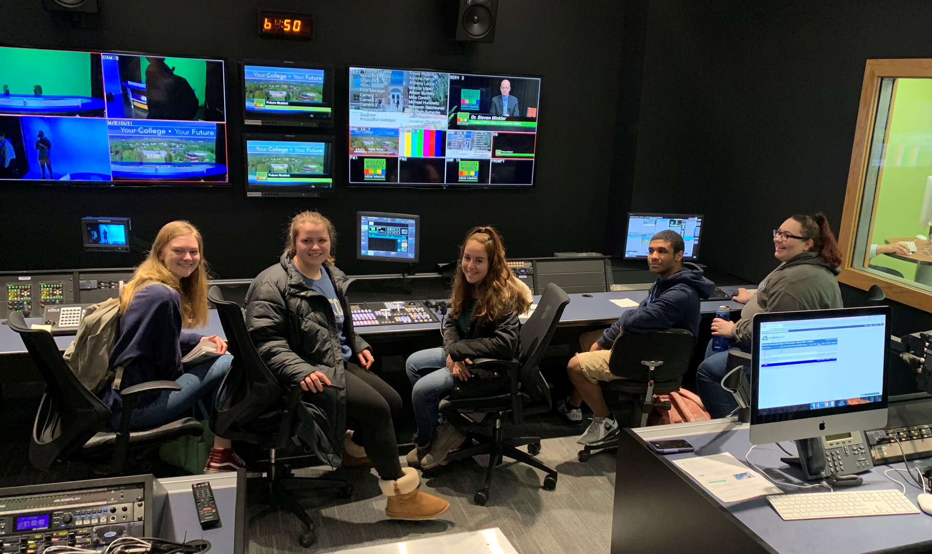 Students in a control booth