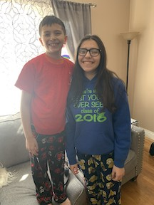 here's a brother and sister in their school outfits