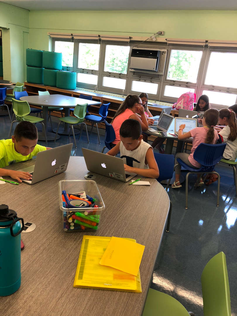 Student coding on computers