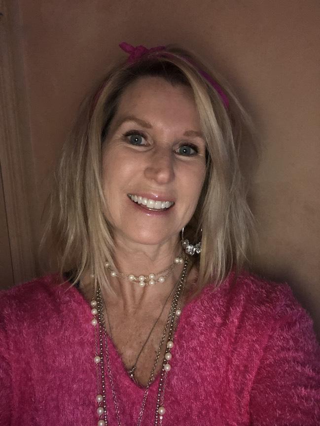 a teacher wearing love beads