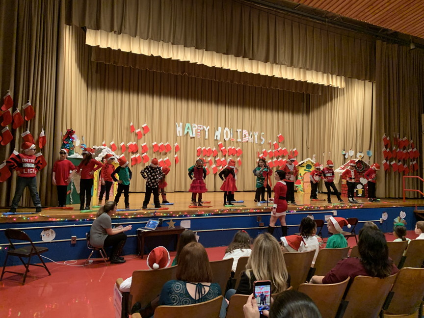 a first grade class performing