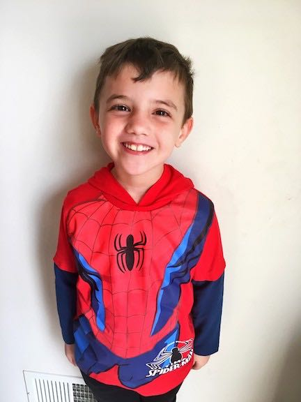 a boy in a hero shirt