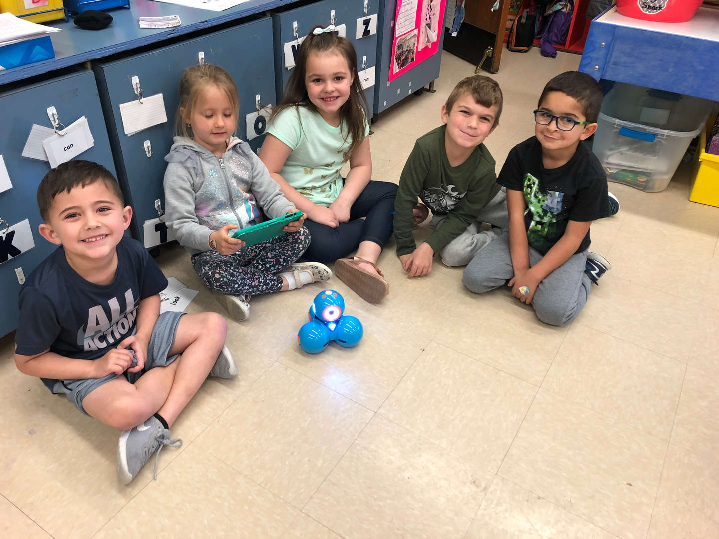 Kindergarteners playing with the robot