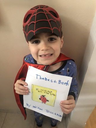 a boy in a spiderman costume