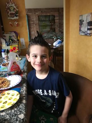 a boy with a gelled hair