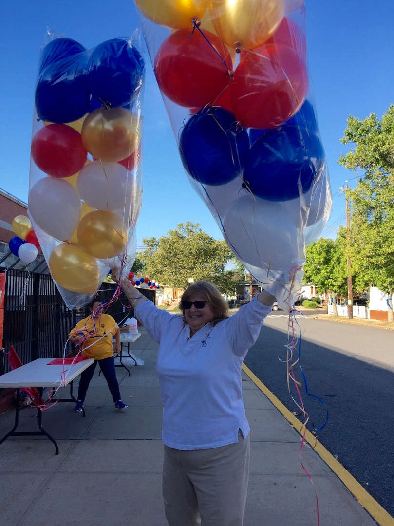 Mrs. Fishman with balloons