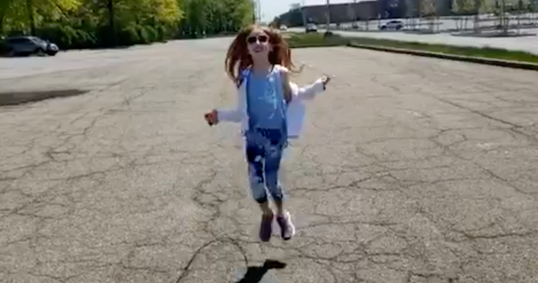 This girl's hair is flying in the air as she jumps