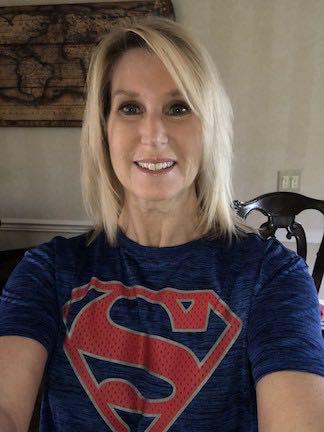 The Kindergarten teacher is wearing her Superman shirt