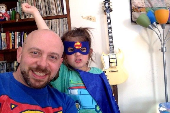 Our music teacher and his daughter are dressed as superheroes