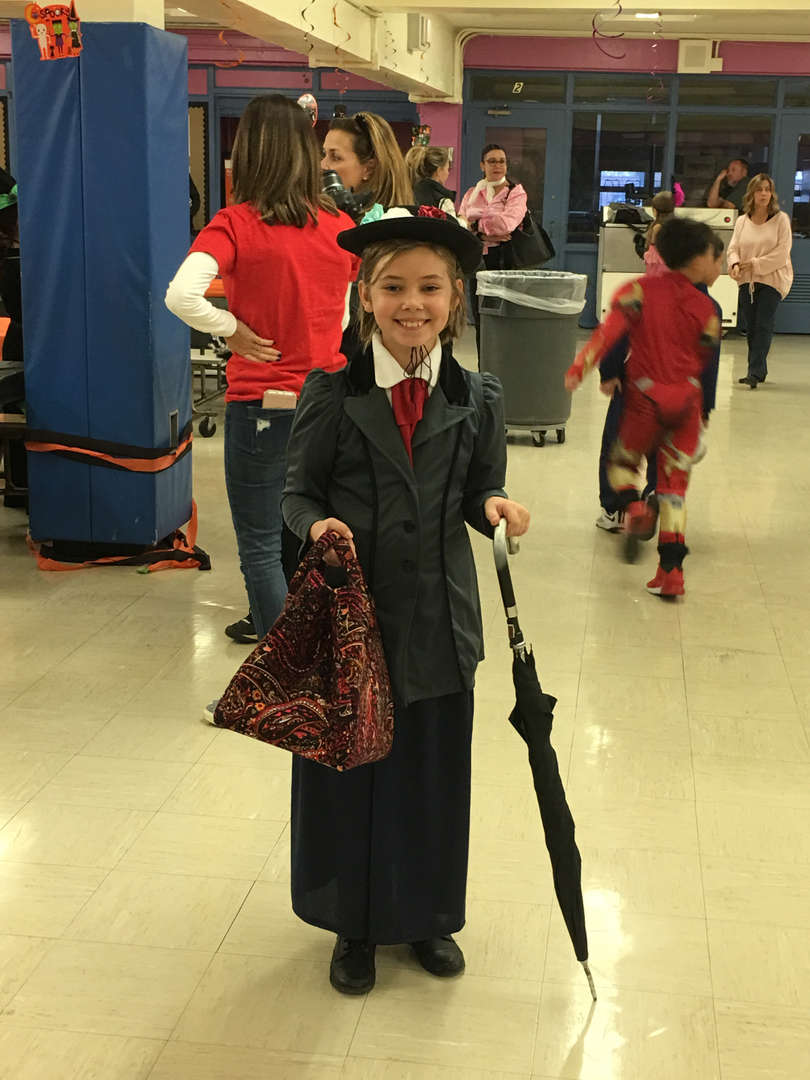 a girl dressed as Mary Poppins