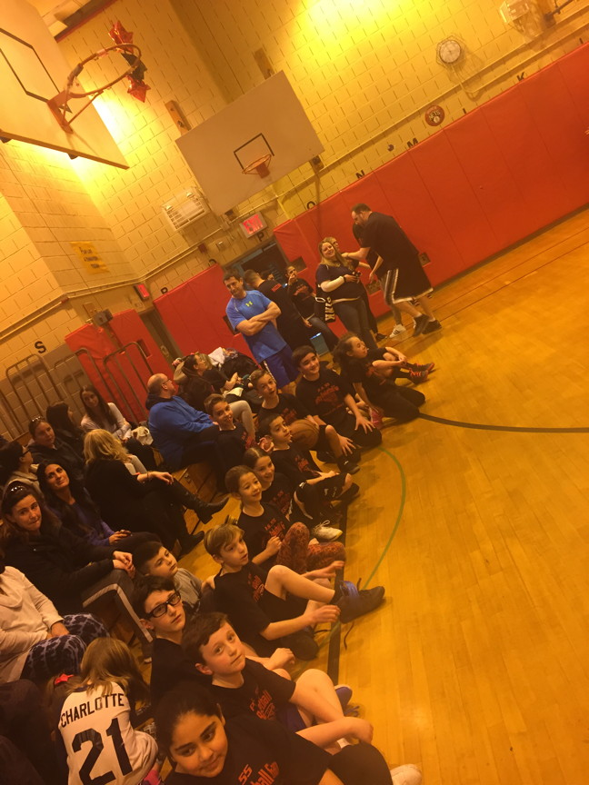 Students on the sidelines watching the game