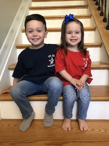 Here's a brother and sister in their school shirts