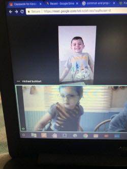 two more children dressed in their superhero shirts on a computer screen