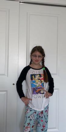a girl in a hero tee shirt