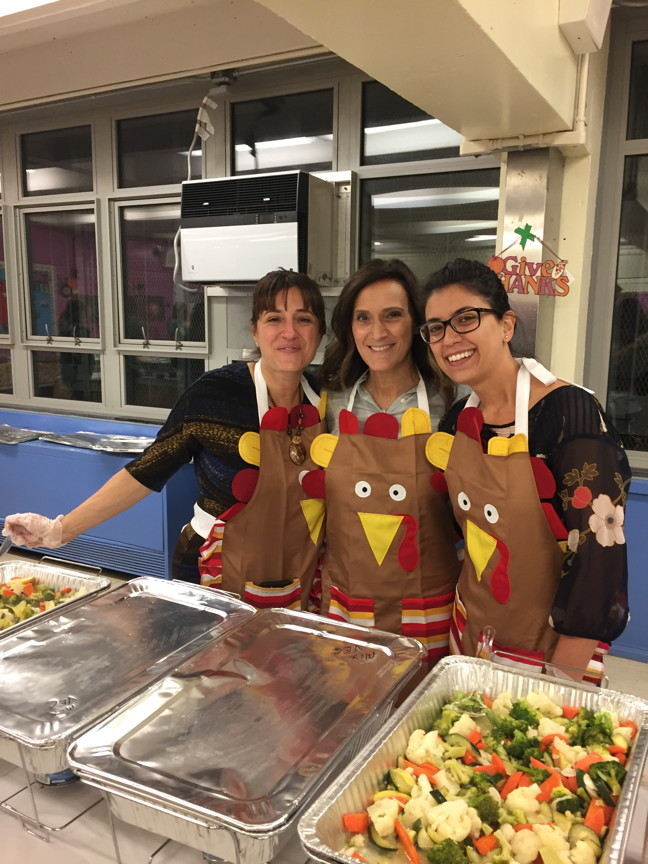 three of our teachers waiting to serve the food