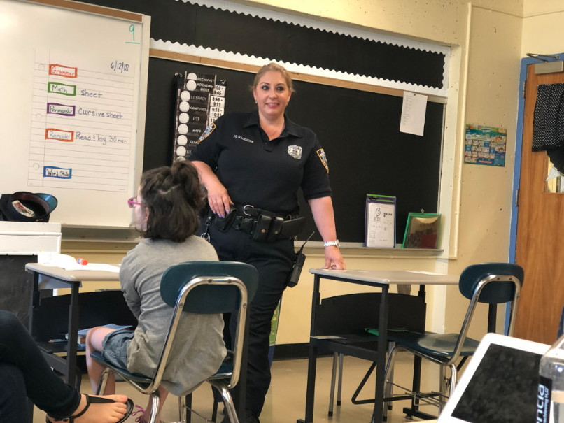 a policewoman speaking to the class