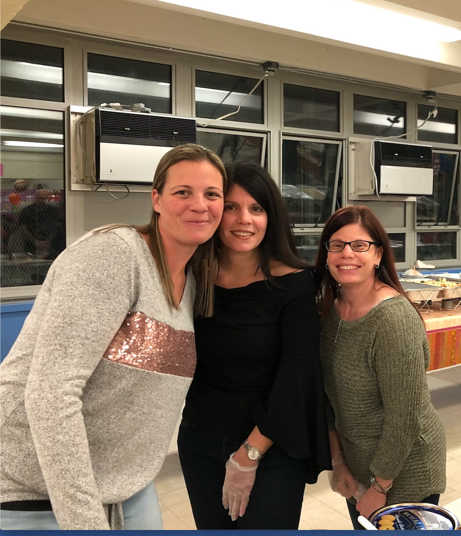 Mrs.Harkins, Mrs.Peragine, and Mrs.Ragusa smiling for the camera