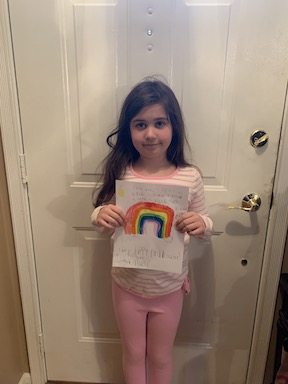 a young girl holding up her rainbow