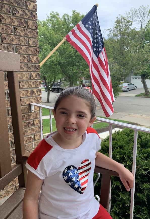 A smiling patriotic girl