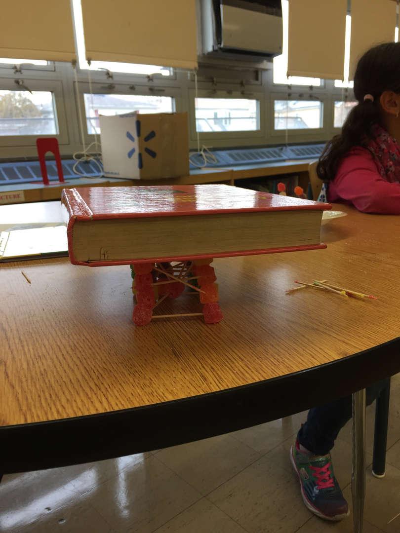 a book balancing on a gumdrop structure