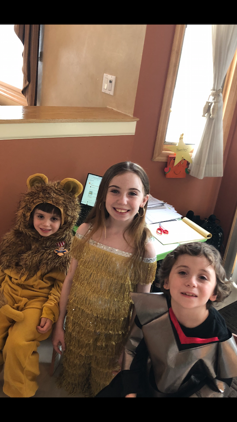 2 sisters and their brother in costume