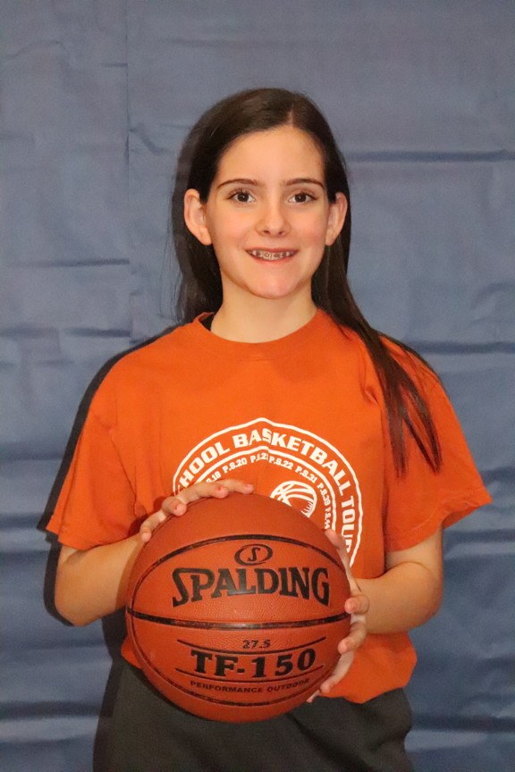 another team member holding the basketball
