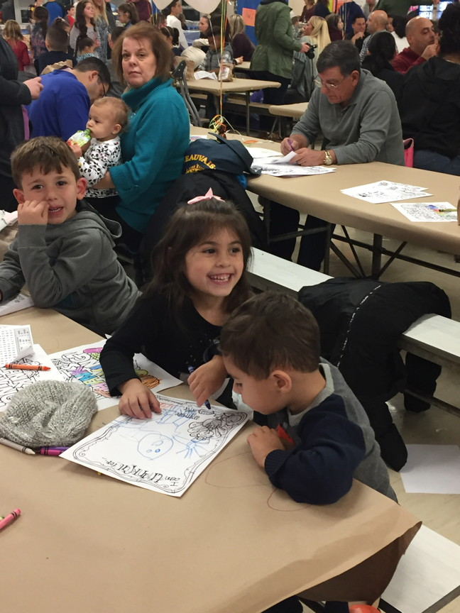 a picture of a girl and two boys coloring