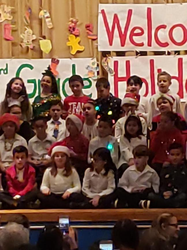other 3rd grade students singing